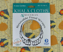 Load image into Gallery viewer, Eco-friendly Beeswax Combo Pack in the print Khalarado, shown in its recyclable packaging on a background of a larger version of the featured print. This print has falling aspen leaves in gold and the Colorado flag, on a background patterned with aspen bark and the Khala & CO logo. Beeswax wraps are an excellent alternative to plastic wrap, as they are durable, long lived, and re-usable, helping you live a Zero Waste lifestyle!