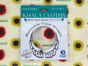 Sustainable Vegan Wax wraps Combo pack in the print Among the Sunflowers in its recyclable packaging on a background of the featured print. Among the Sunflowers is a cheerful collection of traditional yellow and brilliant red sunflowers accompanied by the Khala & CO logo.