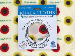 Sustainable Vegan Wax wraps in the size 2 Large in the print Among the Sunflowers, shown in its recyclable packaging on a background of a larger version of the featured print. Among the Sunflowers is a cheerful collection of traditional yellow and brilliant red sunflowers accompanied by the Khala & CO logo.