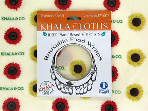 Sustainable Vegan Wax wraps 2 Mini 2 Small pack shown in its recyclable packaging on a background of the featured print. Among the Sunflowers is a cheerful collection of traditional yellow and brilliant red sunflowers accompanied by the Khala & CO logo in green.
