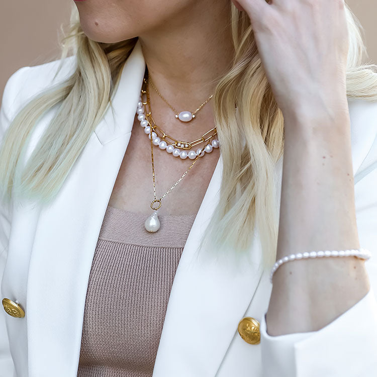 Julie Earrings, Charlotte Pearl Necklace, Paperclip Pearl Trio Necklace, Royal Pearl Necklace, and Ocean Droplet Necklace