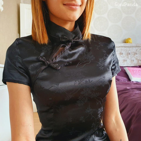 close up front view of lady wearing black satin qipao