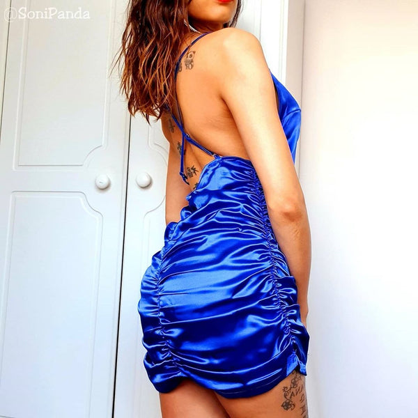back view of sonipanda wearing a blue color satin blue mini party dress