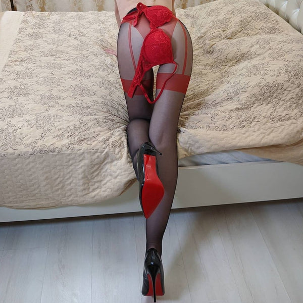back view of lady wearing red sexy sheer pantyhose featuring an open crotch, thigh high silhouette, and comfortable waistband with black shiny high heel