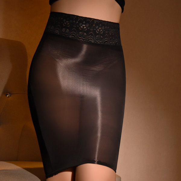 Black sheer mini skirt featuring a lace waistband and sensual shiny nylon.