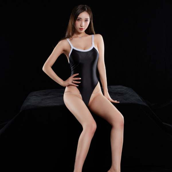 Black wet look bodysuit featuring a scoop neckline, low cut back, adjustable shoulder straps, high cut sides and a thong cut back.