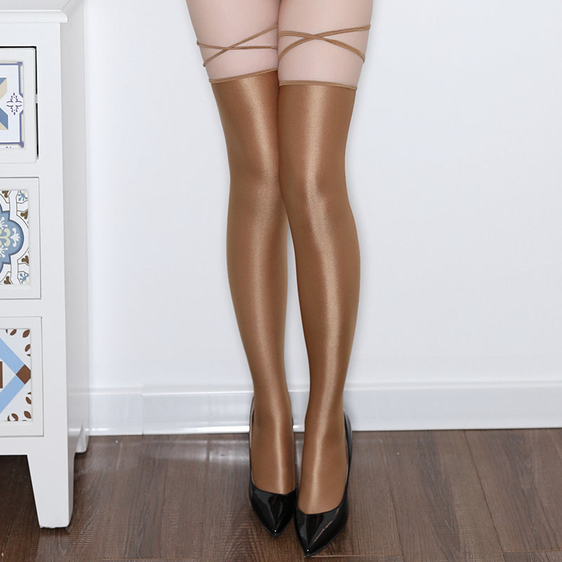 Coffee thigh high stockings featuring shiny nylon and attached straps.