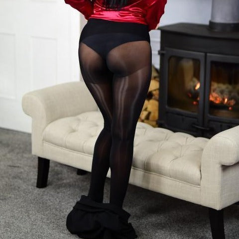 back view of lady wearing black glossy sheer 8 denier pantyhose