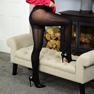 side view of lady wearing black glossy sheer 8 denier pantyhose with black shiny high heels