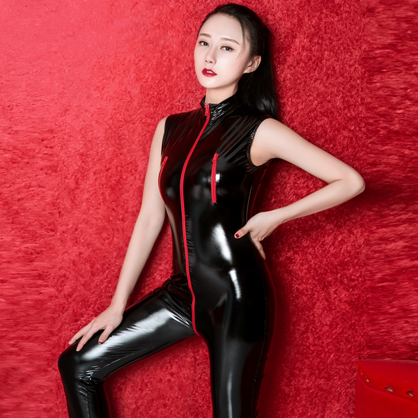 Black wet look bodysuit featuring a high collar, front to crotch zip closure, ankle length.