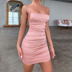 Pink satin mini dress featuring spaghetti straps, adjustable back straps, square neck line, open side panel and a low cut back.
