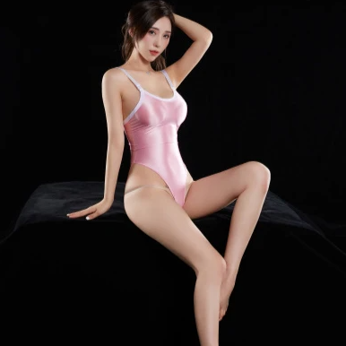 Pink wet look bodysuit featuring a scoop neckline, low cut back, adjustable shoulder straps, high cut sides and a thong cut back.