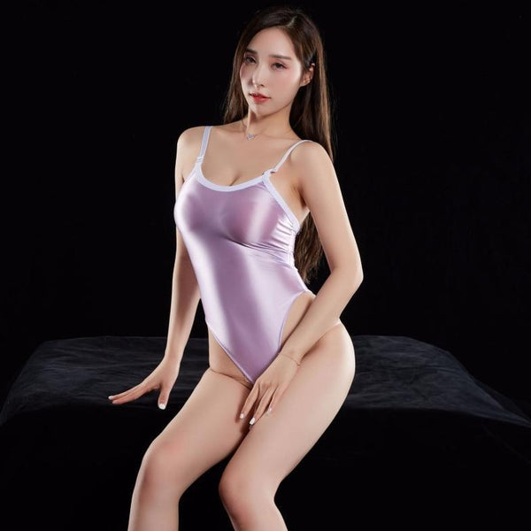 Purple wet look bodysuit featuring a scoop neckline, low cut back, adjustable shoulder straps, high cut sides and a thong cut back.