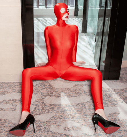 Red catsuit featuring a hooded mask for heighten pleasure, long sleeve, Zipper from hood to crotch, ankle length.