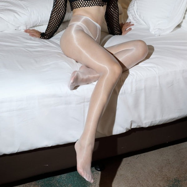front view of lady wearing white glossy sheer 1 denier pantyhose showing off her feet
