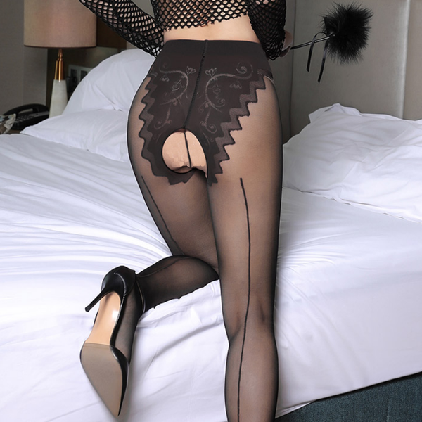 back view of lady wearing red and black pantyhose featuring a classic back seam, an open crotch, and a panty silhouette with intricate floral design with black high heel