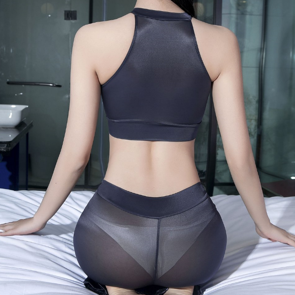 back view of lady wearing grey wet look seductive outfit featuring a crop top with keyhole opening, see through shiny fabric, matching pants.