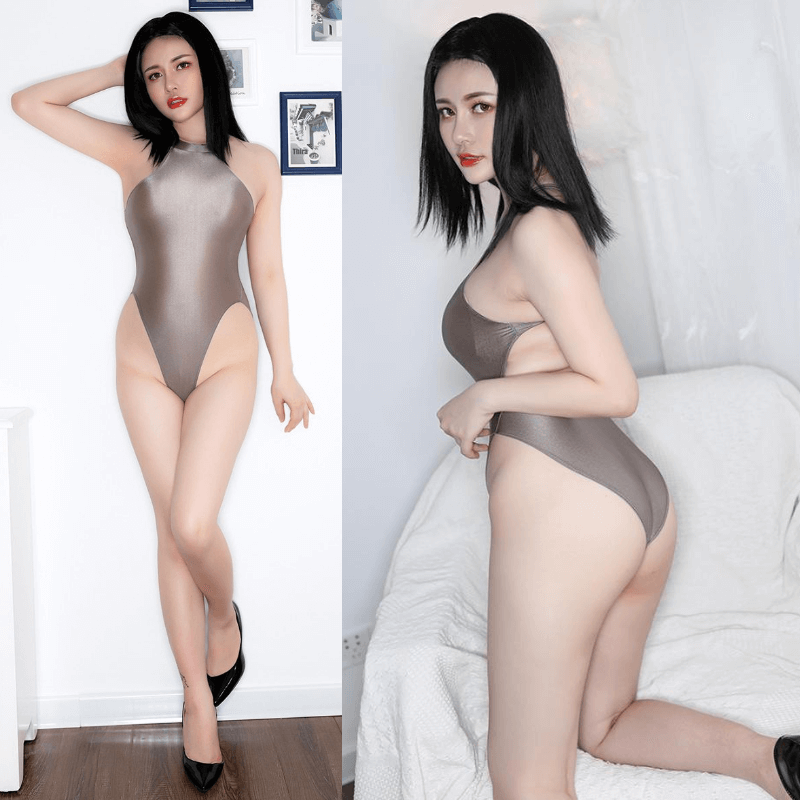 front and back view of lady wearing a grey color wet look bodysuit featuring a high neck, large back keyhole, high cut sides and a cheeky cut back.