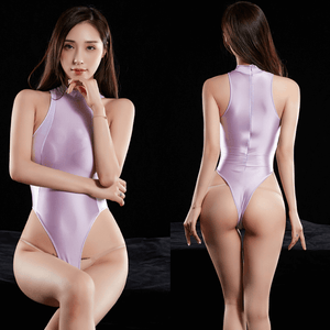 front and back view of lady wearing purple and white wet look bodysuit featuring a high neckline, back zipper closure, high cut sides and a thong cut back.