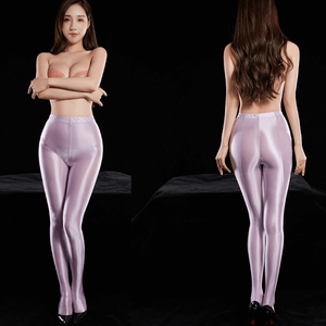front and back view of lady wearing a purple color shiny opaque tights wearing black shiny high heels