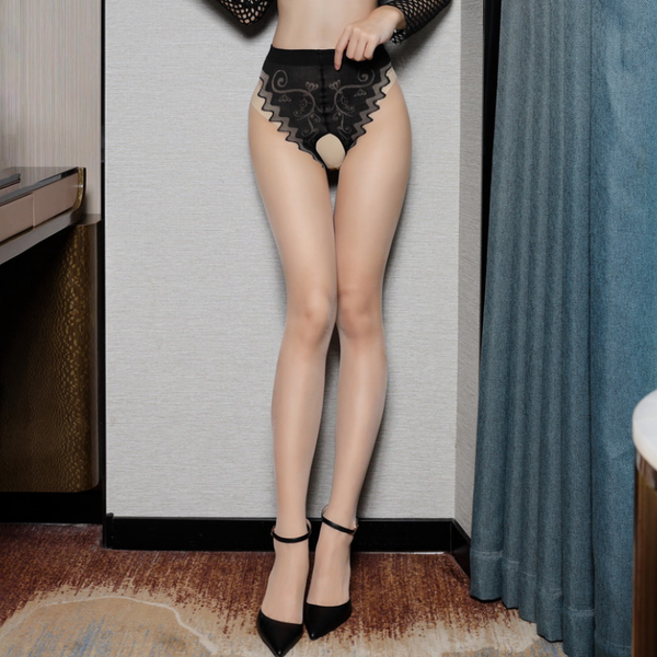 front view of lady wearing black and beige pantyhose featuring a classic back seam, an open crotch, and a panty silhouette with intricate floral design with black high heel