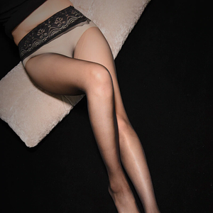 front view of lady wearing black sheer pantyhose with lace waistband