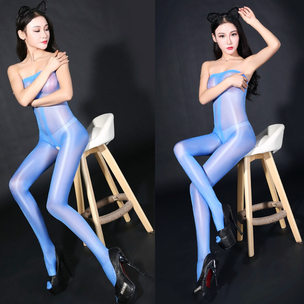 front view of lady wearing glossy blue crotchless bodystocking with black high heels