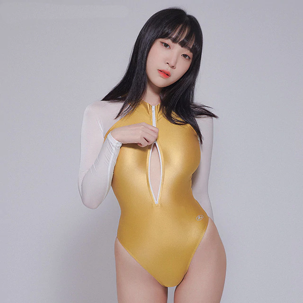 front view of lady wearing gold wet look bodysuit featuring front zipper closure, long sleeves, high cut sides and a cheeky cut back.