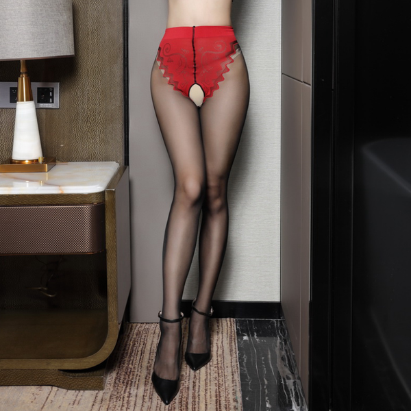 front view of lady wearing red and black pantyhose featuring a classic back seam, an open crotch, and a panty silhouette with intricate floral design with black high heel