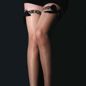 front view of lady wearing hiny thigh stockings featuring leopard print thigh band with black satin bow accent.