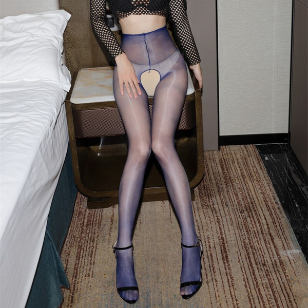 front view of lady wearing fishnet top with black bra with blue crotchless shiny pantyhose with black shiny high heels