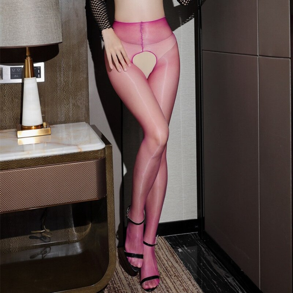 front view of lady wearing fishnet top with black bra with fuchsia crotchless shiny pantyhose with black shiny high heels