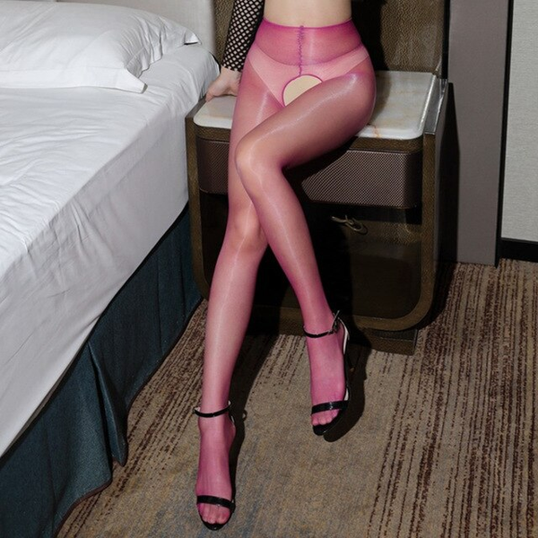 front view of lady wearing fuchsia crotchless shiny pantyhose with black shiny high heels