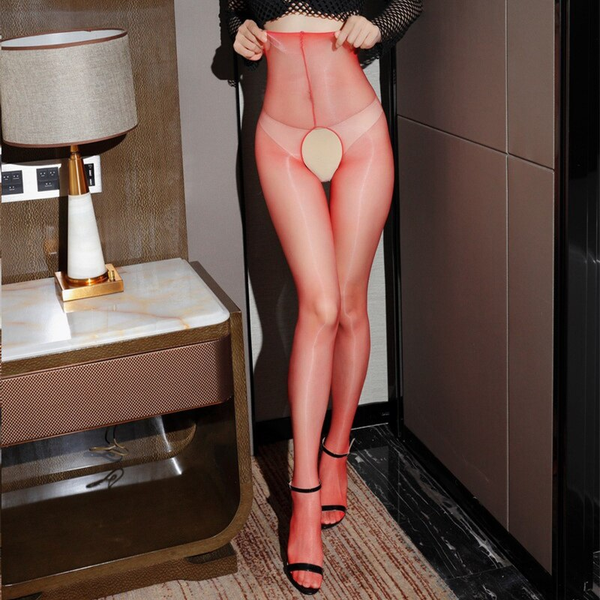 front view of lady wearing fishnet top with black bra with red crotchless shiny pantyhose with black shiny high heels