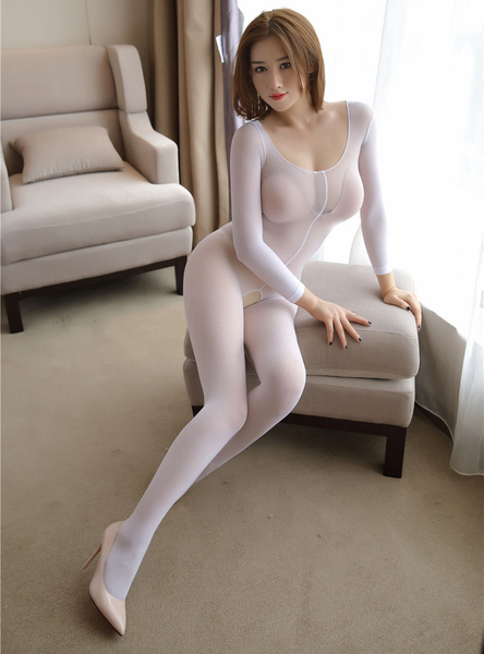 front view of lady wearing white color bodystocking, featuring long sleeves, scoop neck and an open crotch.
