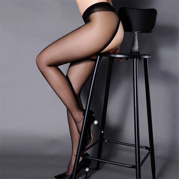 side view of lady wearing black sheer pantyhose featuring an open crotch with black shiny high heels