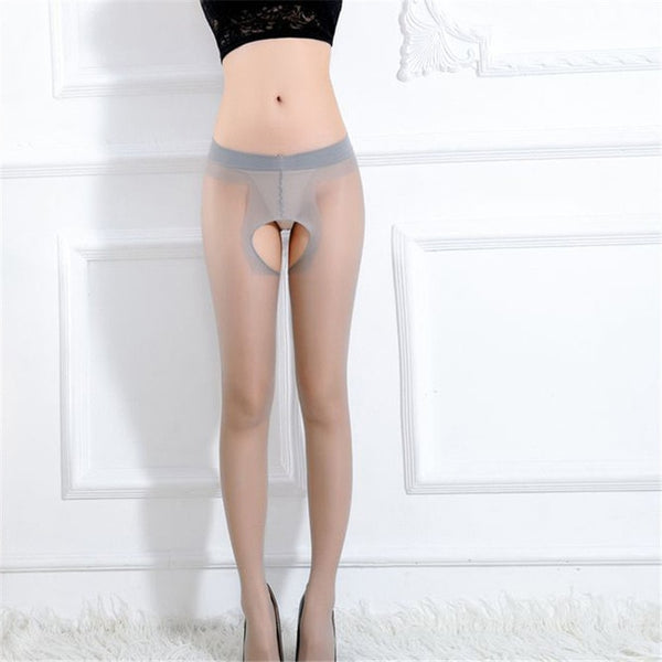 front view of lady wearing grey sheer pantyhose featuring an open crotch