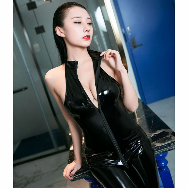 Black sexy bodysuit features a high collar, front zipper closure, an ankle length and shiny finishes.