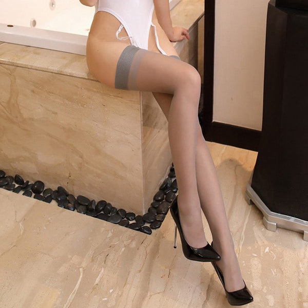 grey sheer thigh high stockings featuring a solid top.