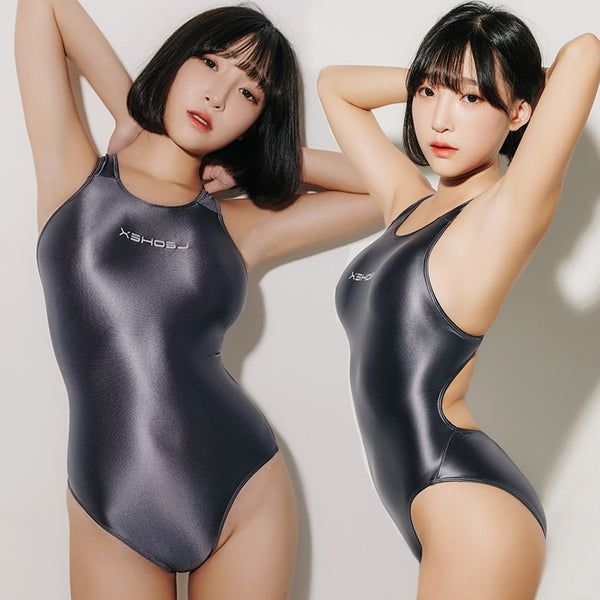front and side view of lady wearing grey wet look swimsuit featuring a scoop neck, cut out back, high cut sides and a brief cut.