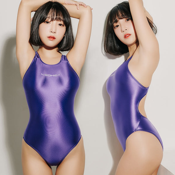 front and side view of lady wearing lavender wet look swimsuit featuring a scoop neck, cut out back, high cut sides and a brief cut.