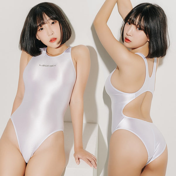 front and back view of lady wearing milky white wet look swimsuit featuring a scoop neck, cut out back, high cut sides and a brief cut.