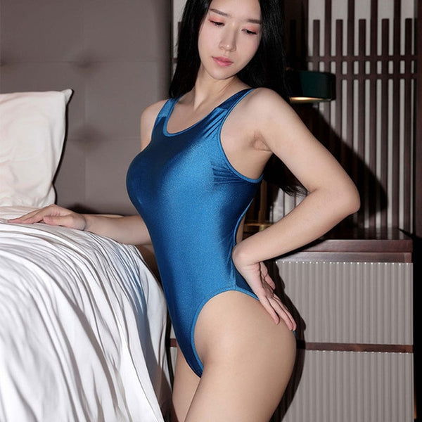 Blue beautiful bodysuit featuring a scoop neck line with shoulder straps, high cut sides and a cheeky cut back.
