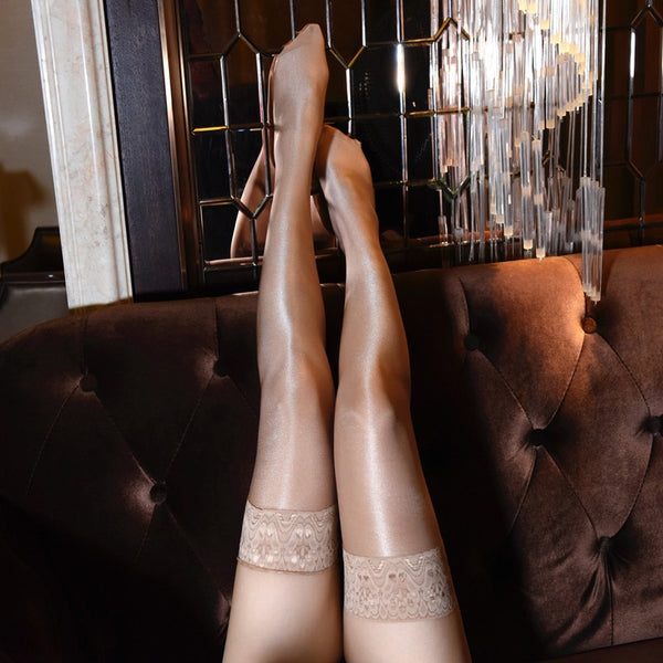 front view of lady wearing brown color oil shine thigh high stockings with floral overlay thigh band showing off her feet