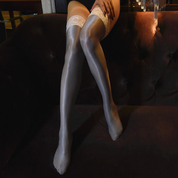 front view of lady wearing grey color oil shine thigh high stockings with floral overlay thigh band showing off her feet