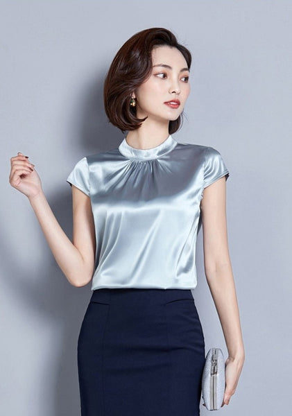 Grey satin top featuring short sleeves, a high neck line, and a fitted silhouette.