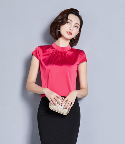 Red satin top featuring short sleeves, a high neck line, and a fitted silhouette.