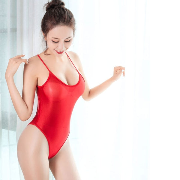 front view of lady wearing red sheer bodysuit featuring a scoop neckline, spaghetti straps, high cut sides and a cheeky cut back.
