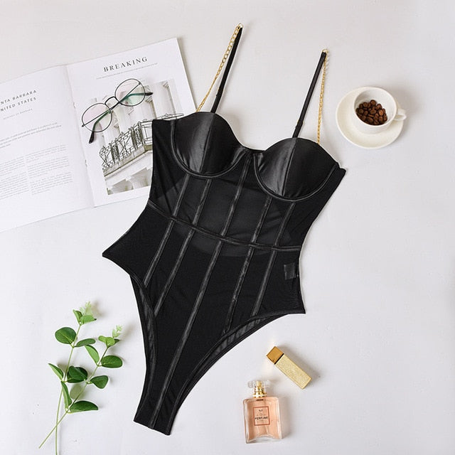 Black sexy bodysuit featuring adjustable chain straps, underwire bust, back hook and eye closure, a mesh bodice and high cut sides.