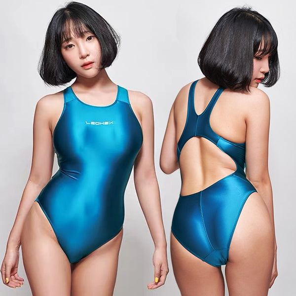 front and back view of lady wearing turquoise wet look swimsuit featuring a scoop neck, cut out back, high cut sides and a brief cut.